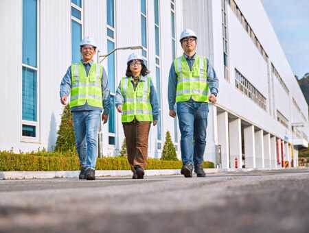 IMI Critical Engineers talking as they walk outside a production plant