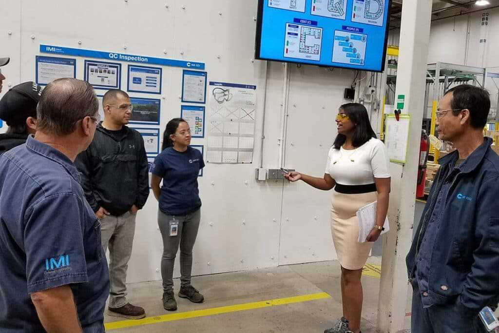 woman giving guide in factory